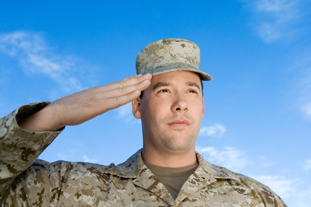 saluting: Soldier