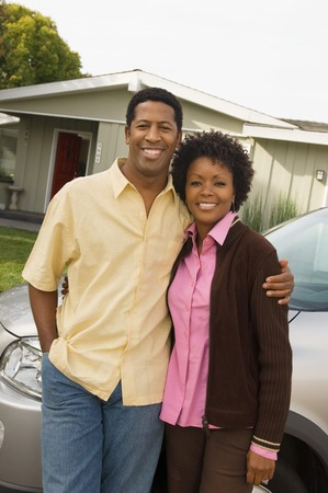 motor home: Couple Standing in Front of Minvan and Home