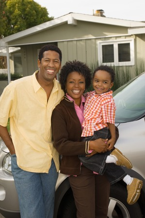 homeowners: Family Standing in Front of Home LANG_EVOIMAGES