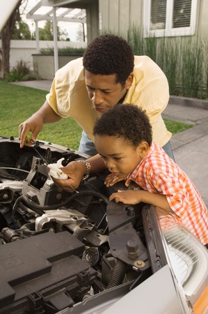 home maintenance: Son Helping Father Check Oil