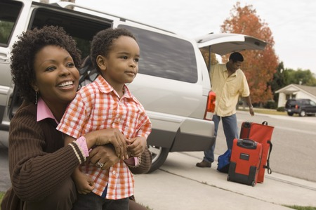 Family Unpacking Minivan Stock Photo - 5476429