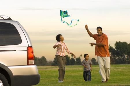 Family Flying a Kite Stock Photo - 5478189