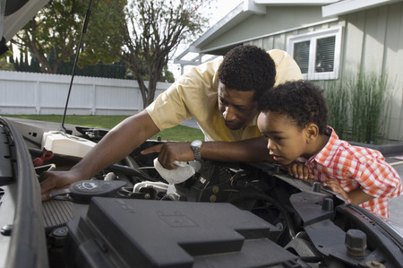 Father and son (5-6) repairing car's engine Stock Photo - 5478192