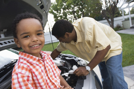 Father and son (5-6) repairing car's engine Stock Photo - 5478193