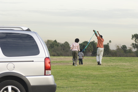 Family with one child (5-6) flying kite Stock Photo - 5476432