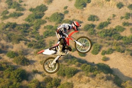 Motocross Racer Mid-Air Stock Photo - 5478224