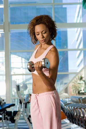 muscle toning: Woman Using Dumbbell LANG_EVOIMAGES