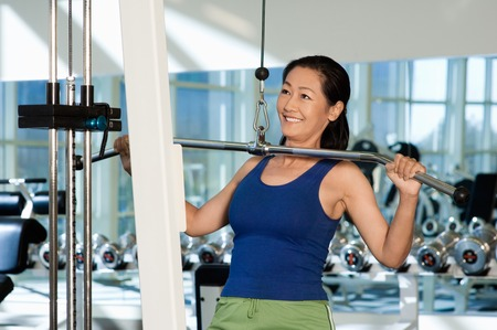 muscle toning: Woman Using Exercise Equipment