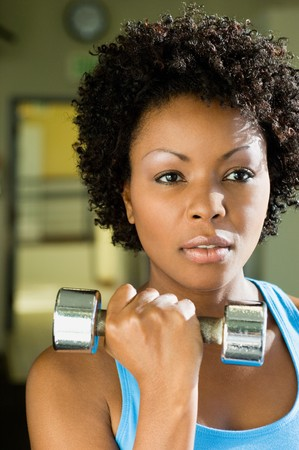 Woman Using Dumbbell Stock Photo - 5478235