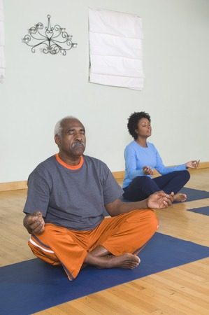 well beings: Senior Man Meditating in Yoga Class LANG_EVOIMAGES