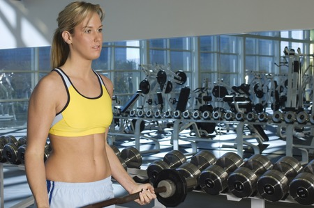 muscle toning: Woman Weightlifting With Barbell