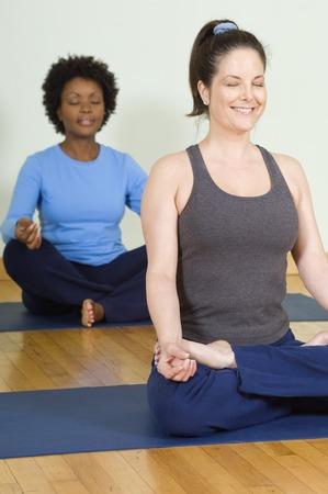 30 35 years women: Women Meditating in Yoga Class