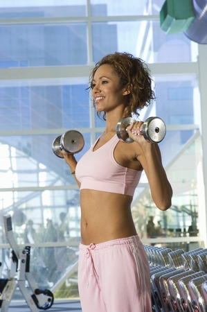 Woman Weightlifting With Dumbbells Stock Photo - 5478251