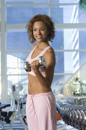 muscle toning: Woman Weightlifting With Dumbbell