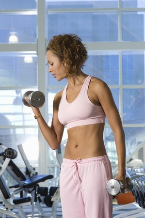 Woman Weightlifting With Dumbbells Stock Photo - 5478255