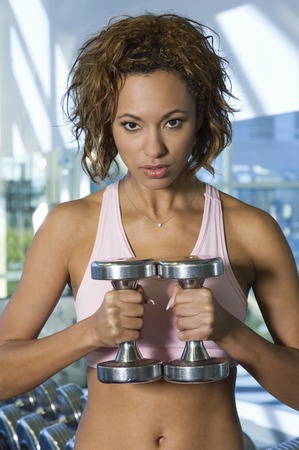 Woman Weightlifting With Dumbbells Stock Photo - 5478257