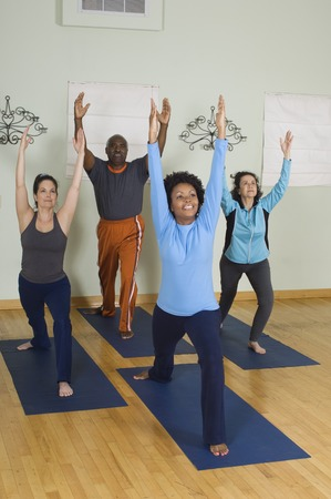 racially diverse: Stretching in Yoga Class