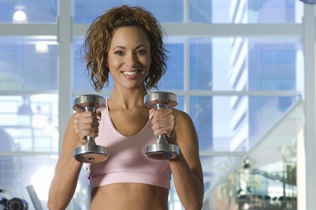 Woman Weightlifting With Dumbbell Stock Photo - 5478259