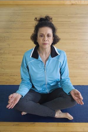 65 70 years: Senior Woman Meditating