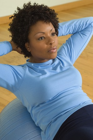 Woman Doing Sit-Ups With Exercise Ball Stock Photo - 5478263