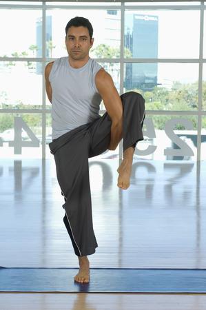 men 45 years: Man Practicing Yoga