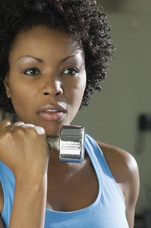levantamiento de pesas: Halterofilia de mujer con Dumbbell
