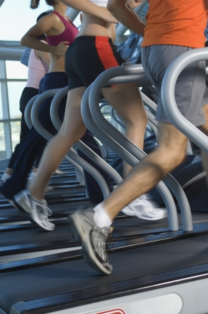 fitness equipment: Joggers on Treadmills in Gym