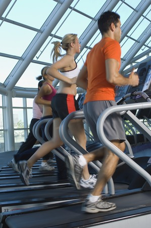 athleticism: Joggers on Treadmills in Gym