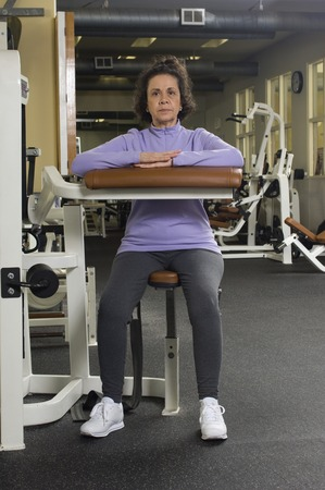 65 70 years: Senior Woman Working Out in Gym LANG_EVOIMAGES