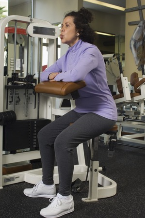 well beings: Senior Woman Working Out in Gym LANG_EVOIMAGES
