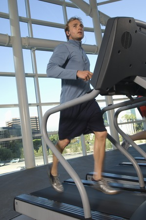 Man Jogging on Treadmill at Gym Stock Photo - 5478291