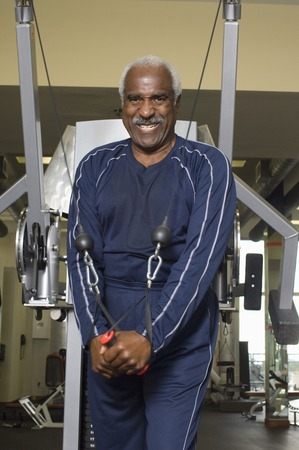 one mature man only: Senior Man Working Out on Weightlifting Machine LANG_EVOIMAGES