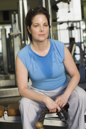 well beings: Woman Working Out in Gym