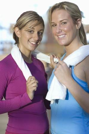 perspiring: Young Women Holding Towels After Exercising LANG_EVOIMAGES