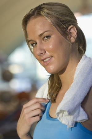Young Woman Holding Towel After Exercising Stock Photo - 5478308