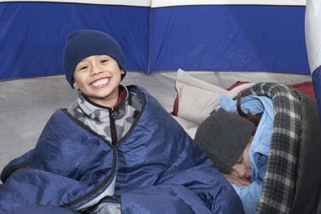 biracial: Brother and Sister Relaxing in Tent