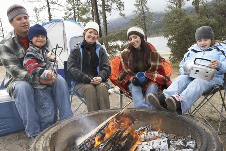 bivouac: Family Gathered Around Campfire