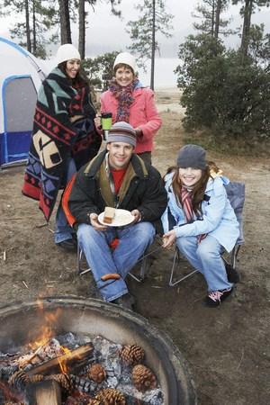 Family Gathered Around Campfire Stock Photo - 5478313