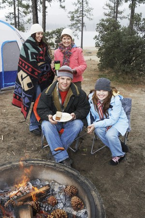 eating area: Family Gathered Around Campfire