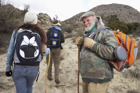 early 60s: Family Hiking in Desert LANG_EVOIMAGES