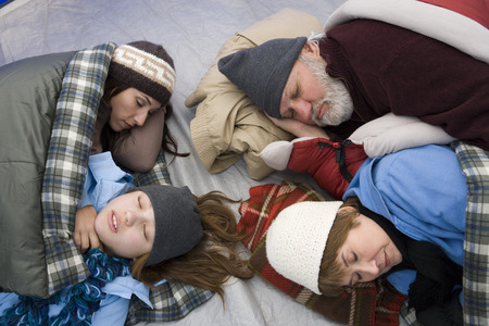 sleeping bag: Family sleeping in tent LANG_EVOIMAGES