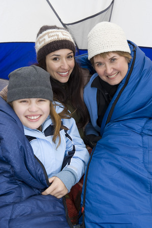Family sitting in tent, smiling, portrait Stock Photo - 5478333