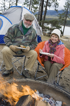 Senior couple eating by tent Stock Photo - 5478334