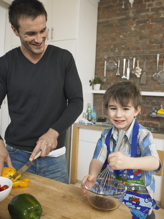late 30s: Father and Son Cooking Together