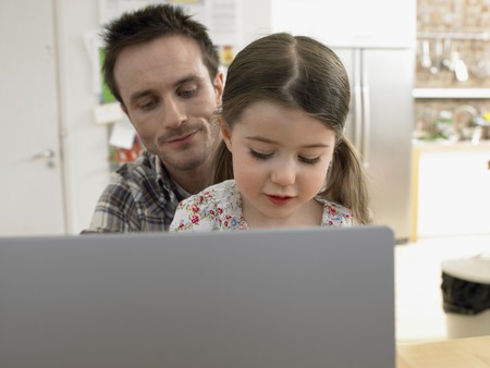 mundane: Father and Little Girl Using Laptop Together