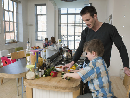35 to 40 year olds: Son Helping Father in Kitchen
