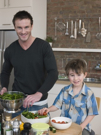 35 years old man: Father and Son Preparing Salad