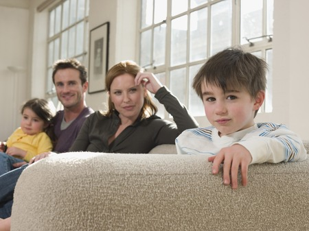 relaciones humanas: Little Boy on Sofa With Family