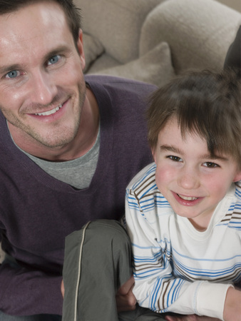 35 years old man: Father and Son on Sofa