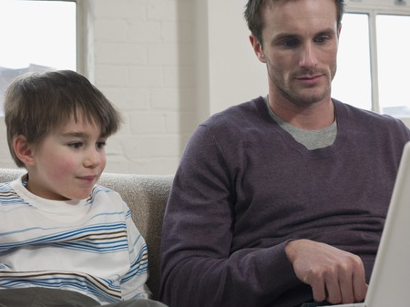 35 years old man: Son Watching Father Use Laptop